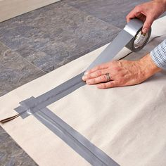 Lowes Creative Ideas: Turn a drop cloth into a custom-colored rug with paint and tape. More