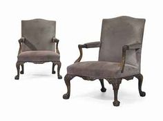 A PAIR OF GEORGE II MAHOGANY LIBRARY ARMCHAIRS  ATTRIBUTED TO PAUL SAUNDERS, CIRCA 1755-60  Each with a shaped padded back, arms and serpentine seat covered in brown suede, with acanthus and rose-carved outswept arms, with a shaped, foliate-carved apron on cabochon-headed cabriole legs, one inscribed in pencil 211 Grary Calder and the other inscribed Calder No2, previously parcel-gilt, formerly with recessed casters (2)