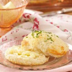 Blue Cheese Biscuits. Ingredients  2 individually frozen biscuits  1 tbsp butter  1 tbsp crumbled blue cheese  2 tsp minced fresh parsley  Directions  Place biscuits in an ungreased 9-in. round baking pan. In a small microwave-safe dish, combine butter and blue cheese. Microwave, uncovered, on high until butter is melted; spoon mixture over biscuits.  Bake according to package directions. Sprinkle with parsley.     I'm not too fond of blue cheese myself but this does give me ideas. :)
