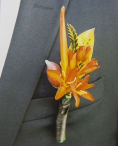 Tropical boutonniere perfect for a destination beach wedding.