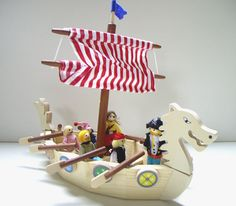 cool tiny model of a viking ship with simple oars and shields