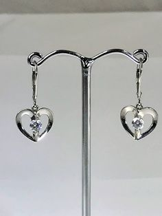 Lovely Sterling Silver and Cubic Zirconia Heart Shaped Earrings by LoubooluJewellery on Etsy Heart Shaped Earrings, Heart Shapes, Silver Earrings, Sterling Silver, Trending Outfits, Unique Jewelry, Handmade Gifts, Etsy, Vintage
