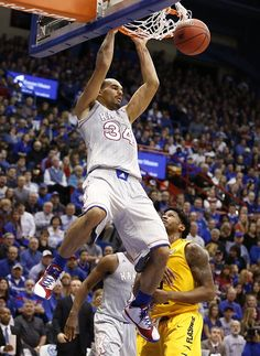 Kansas forward Perry Ellis (34) delivers a dunk off a lob over Kent State forward Craig Brown (15) during the first half on Tuesday, Dec. 30, 2014 at Allen Fieldhouse. #KU