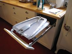 Bungalow kitchens often had things like built-in ironing boards. So I decided to put one in mine, too -- using IKEA's ironing board fixture. Here it is folded up to put away. You just slide it into the drawer.