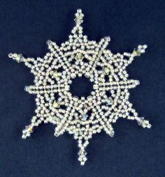 Christmas - Beaded Snowflake #29 Ornament Pattern http://www.ecrafty.com/casearch.aspx?SearchTerm=snowflake