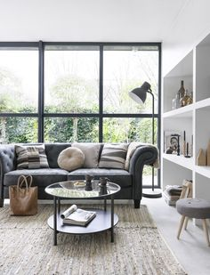 Muted elegant modern living room in grey and white via Kim Timmerman.