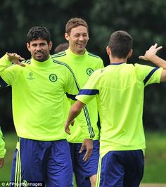 Costa and Oscar show off what looks to be a special handshake