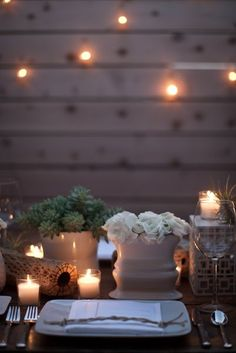 maybe build a pallet wall for the backyard with strung lights..?