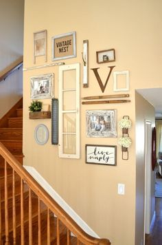 Vintage Inspired Staircase Gallery Wall. Vintage farmhouse wall decor ideas.