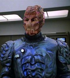 Hirogen -a vicious race of aliens who hunt, kill and butcher other races for purely sport.The Voyager crew encountered them and were saved twice by them. The first time by pitting them against Species 8472 and second by hiding in the Hollodeck.  7 was aided by one when she was taken for death matches. In the novels they were pitted up against the Malon.