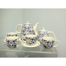An Elegant English Style Tea Service for 4 - Set includes a electric ceramic kettle, milk pitcher (or use as steeping teapot), four Teacups, and four matching saucers. A Kettle/pot features a lovely blue paisley design - also known as China Indigo Flower pattern. Absolutely gorgeous! With this stylish tea set in your home, you are guaranteed to be able to relax and entertain in style! Great for Home, Office, Restaurant table service, Catered Events - or a Lovely Gift for that special…