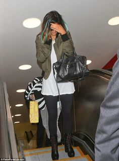 Travelling light: Kylie Jenner didn't appear to have any luggage with her at the airport