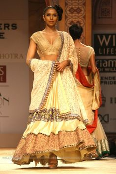 A model displays a creation by designer Manish Malhotra at the Wills Lifestyle India Fashion week 2012