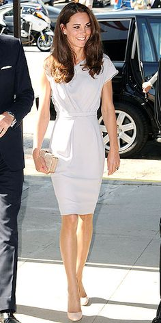 dove gray, draped sheath by London-based designer Roksanda Ilincic, paired with beige Jimmy Choo pumps and clutch.