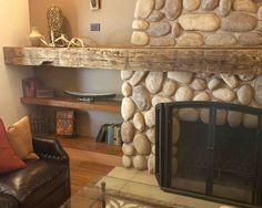 I love the way this mantle juts out past the fireplace to create a shelf.