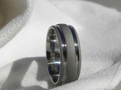 Titanium Ring Sandblasted Gray Wedding Band AX32. $43.00, via Etsy.