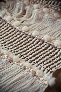 Raw Wool Arete Handwoven shawl by JuliaAstreou on Etsy -- How are these isolated sections created so that they stay in place?  I love this!