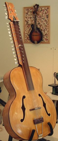 THE MOHAN VEENA - a recently developed Indian instrument, it has 3 melody, 5 drone and 12 sympathetic strings. It is played like a lap steel guitar using a metal slide to note. The sound is somewhere between a sitar and a sarod, but with beautiful slides between notes. Created by Vishwa Mohan Bhatt.