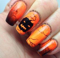 Day 19: Glow in the dark pumpkin nails by Tammy U. (Instagram @ohmygoshpolish).