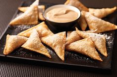 Won ton wrappers are stuffed with a mixture of pumpkin, caramel, spices and sour cream in this simple, yet elegant, dessert.
