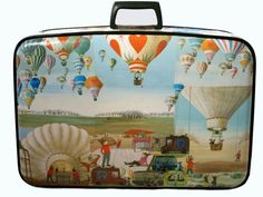 Incredible decoupaged vintage suitcase at the Rhinestone Armadillo Etsy shop...