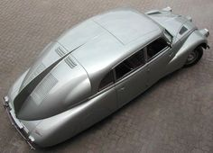 The Tatra 87 has a unique bodywork. Its streamlined shape was designed by Hans Ledwinka and Erich Übelacker, and was based on the Tatra 77, the first car designed for aerodynamic purposes. The body design was based on proposals submitted by Paul Jaray of Hungarian descent, who designed the famous German Graf Zeppelin dirigibles. A fin in the sloping rear of the Tatra helps to divide the air pressure on both sides of the car, a technique used in later aircraft.