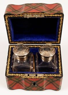 Tartanware box with two glass jars and beautiful ornate lids.