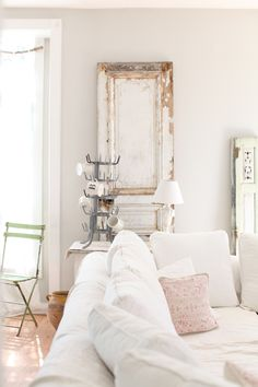 Warm white and soft pinks and pastels are so pretty.  This is the Ralph Lauren color.  I also use vintage french linen sheets to cover my couches.
