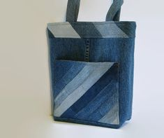 This medium size tote bag, handbag or purse constructed from upcycled denim jeans and repurposed cotton fabric is a perfect size to