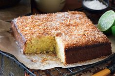 I'm thinking...  this lime and coconut cake, cut into small squares and covered in white chocolate ganache and coconut to make........ lime and coconut lamingtons!