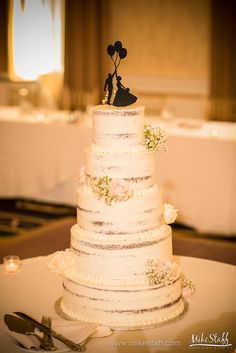 Naked wedding cake with pink roses and baby's breath #wedding #cake #Michiganwedding #Chicagowedding #MikeStaffProductions #wedding #reception #weddingphotography #weddingdj #weddingvideography #wedding #photos #wedding #pictures #ideas #planning #DJ #photography