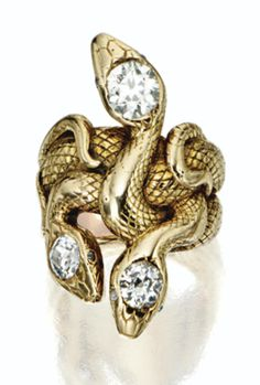 Gold and diamond serpent ring, late 19th Century. Designed as three entwined serpents, the bodies engraved with scales, the heads set with 3 old-mine diamonds weighing approximately 2.10 carats. #antique #serpent #ring