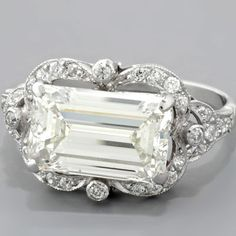 ALMOST IDENTICAL TO MY STONE - NEVER SEEN ANYTHING SET LIKE THIS.  Emerald-cut Art Deco-style engagement ring. Beautiful! //MD