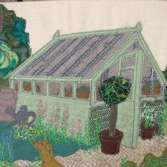 Greenhouse (& dog) in appliqué and machine embroidery.