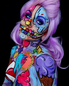 The body is the ultimate canvas for stunning works of art. This candy skeleton girl proves that. #skeleton #candy #art #Beautiful #body #paint #canvas