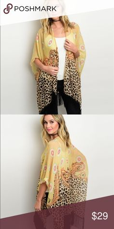 """Leopard Print Cover Up Wear with a dress, over a bikini or as shown, this piece will spice up any look!  Fabric Content: 100% POLYESTER Description: L: 35"""" W: 68""""  ❌Trades / Offers ✅ Firm Price Tops"""
