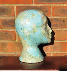 ***This item is made to order. The pictures shown are for generic use. Therefore, the mannequin head that you receive may vary slightly to the pictures shown. The head will be made and shipped within two weeks of purchase***    Height: 12  Head Circumference 21    This mannequin head which has been decoupaged with an old UK Road Atlas, and then coated with a special glaze to ensure durability and a glossy, smooth finish. You can display this unique and quirky sculpture in a bedroom to hang…