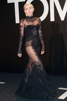 In a black lace dress at the Tom Ford presentationonFeb. 20, 2015 in Los Angeles.  -Cosmopolitan.com