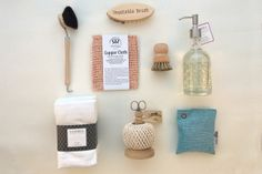 Mason Grace - Kitchen Beautiful gift basket.  Redecker kitchen scrubbies, Caldrea hand towels and hand soap.  Twine ball and stand.  Moso charcoal.