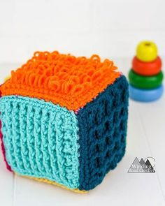 Crochet Sensory Block Free Pattern - Winding Road Crochet This crochet sensory block is a great toy for babies and toddlers. Learn to make one with this free crochet tutorial and be ready for the next baby shower. Crochet Ball, Crochet Baby Toys, Crochet Toys Patterns, Crochet Crafts, Crochet Projects, Free Crochet, Knitting Patterns, Ravelry Crochet, Crochet Birds