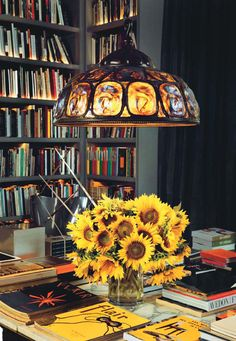 A c. 1900 Louis Comfort Tiffany lamp in the library hangs over a 1930 Marc du Plantier table.