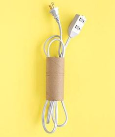 Contain extra extension cords by wrapping the length of one around your hand then sliding the whole thing inside the tube.