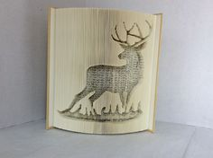 Deer in Grass Cut and Fold Book: By Rebecca's Book Art Book Folding Patterns, Craft Patterns, Book Sculpture, Sculptures, Cut And Fold Books, Paper Art, Paper Crafts, Deer Pattern, Honeymoon Planning