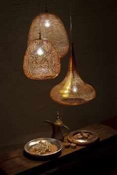 Made in a factory in Egypt from silver-plated copper, the lamps have been punctured with thousands of tiny holes that create stunning effects when the light filters through them and casts shadows on the surrounding surfaces. Zenza's handmade lights are unique in every way and will add a distinctive sense of character and personality to every home that features them.