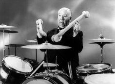Drummin' with femur bones | 22 Photos Of Alfred Hitchock Being A Big Goof