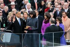 Supreme Court Chief Justice John Roberts administers the oath of office to President Obama during the inaugural swearing-in ceremony at the U.S. Capitol in Washington,D.C.,1/21/2013.First Lady Obama holds a Bible that belonged to Dr.Martin Luther King Jr.,and the Lincoln Bible,which was used at President Obama's 2009 inaugural ceremony. Daughters Malia and Sasha stand with their parents.