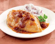 Slow-Cooker Chicken with Bacon Orange Sauce Recipe - This easy set-and-forget savory meal has a touch of sweetness. And..our smoky flavored bacon makes everything better! #Schwans #EasyRecipes #Inspiration