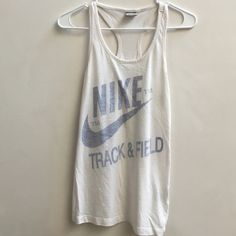 Nike track and field running tank top Size small. Light use. No major stains etc. some darkening around underarms if anything. Can't even notice it. Make an offer :) Nike Tops Tank Tops