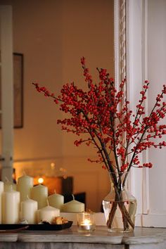 Candles and berry/flower plants.  Simple, perfect for the cooler months and brings in nature from outside.  Simple and calm.