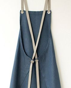 This Kitchen Apron in a luscious dark slate-blue linen. Its elegant, but thoroughly tested and approved for durability. Comfortable straps fit to your body and eliminate any strain on your neck. linen, finished with sturdy nickel-plated grommets and s Sewing Aprons, Sewing Clothes, Diy Clothes, Sewing Hacks, Sewing Crafts, Sewing Projects, Sewing Tips, Fabric Crafts, Linen Apron
